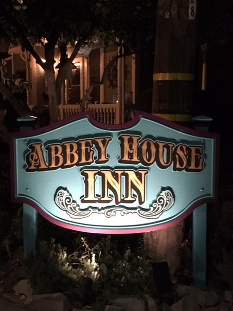 our sign illuminated at night